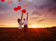 Wedding couple with balloons Royalty Free Stock Images