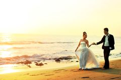 Wedding couple at beach. Portrait of wedding couple honeymoon at beach Stock Images