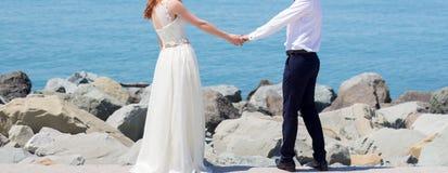 Wedding couple on the beach. At the Black Sea stock photos