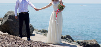 Wedding couple on the beach. At the Black Sea stock photography