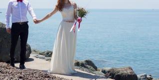 Wedding couple on the beach. At the Black Sea royalty free stock photos