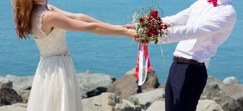 Wedding couple on the beach. At the Black Sea stock photo