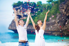 Wedding couple. Wedding on the beach with flower petals Stock Photos