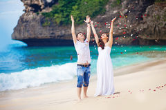 Wedding couple. Wedding on the beach with flower petals Royalty Free Stock Photos