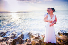 Wedding couple at the beach Stock Photos