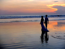 Wedding couple on beach at sunset Royalty Free Stock Photography