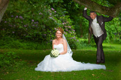 Wedding couple below oak tree Royalty Free Stock Photo