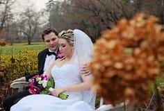 Wedding couple on bench Royalty Free Stock Image