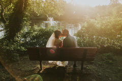 Wedding couple on bench Royalty Free Stock Image
