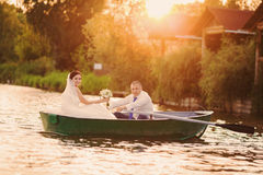 Wedding couple on a boat on the lake Royalty Free Stock Photo
