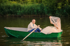 Wedding couple on a boat on the lake Royalty Free Stock Photography