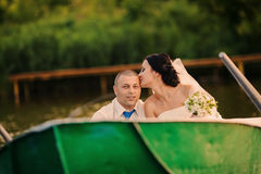 Wedding couple on a boat on the lake Stock Image