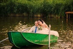 Wedding couple on a boat on the lake Royalty Free Stock Photos
