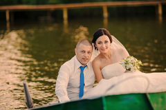 Wedding couple on a boat on the lake Stock Photography