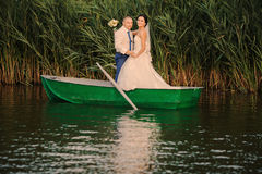 Wedding couple boat lake Royalty Free Stock Images