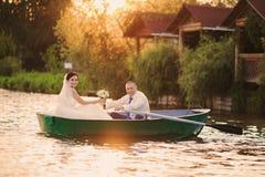 Wedding couple boat lake Royalty Free Stock Image