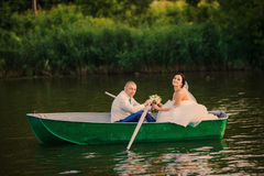 Wedding couple boat lake Stock Photo