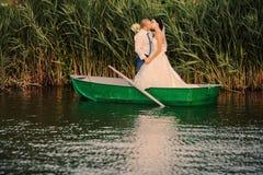 Wedding couple boat lake Royalty Free Stock Photos