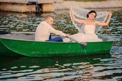 Wedding couple boat lake Stock Images