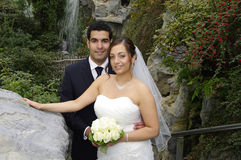 Wedding couple in botanical garden Stock Images