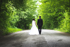 Wedding. Brand new couple walking on the road and having their time Royalty Free Stock Images
