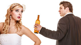 Wedding couple, bride with alcoholic drinking groom. Royalty Free Stock Images