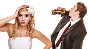 Wedding couple, bride with alcoholic drinking groom. stock photography