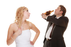 Wedding couple, bride with alcoholic drinking groom. Stock Images