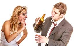 Wedding couple, bride with alcoholic drinking groom. Stock Image