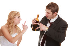 Wedding couple, bride with alcoholic drinking groom. royalty free stock image