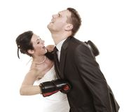 Wedding couple. Bride boxing groom. Conflict. Stock Photo