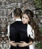 Wedding couple, bride embracing groom Stock Image