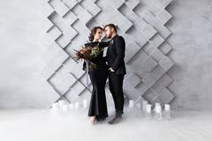 Wedding Couple, Bride and Groom fashion portrait, over gray volumetric background with copyspace. Dry ice smoke. Wedding Couple, Bride and Groom fashion Royalty Free Stock Photos
