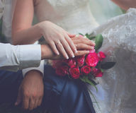 Wedding couple, bride and groom, hands with rings and pink gentle bouquet flowers closeup, country, rustic style