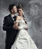Wedding couple, bride and groom. Over gray grunge background Stock Photography