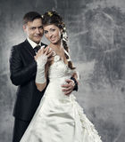 Wedding couple, bride and groom. Over gray grunge background Royalty Free Stock Photos