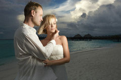 Wedding couple, bride and groom standing under threatening cloud Royalty Free Stock Photography