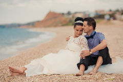 Wedding couple, bride and groom, walking on a Stock Image