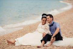 Wedding couple, bride and groom, walking on a. Wedding couple walking on a beautiful beach Stock Photo