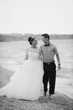 Wedding couple, bride and groom, walking on a. Wedding couple walking on a beautiful beach Royalty Free Stock Image