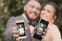 Wedding couple bride with mobiles phone close up photo