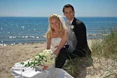 Wedding Couple By The Sea Stock Images