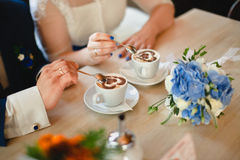 Wedding couple in a cafe drinking coffee royalty free stock image