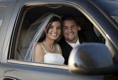 Wedding couple in car Stock Images