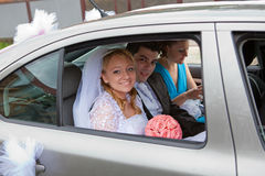 Wedding couple in car Royalty Free Stock Image