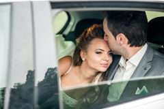 Wedding couple in the car Stock Photography