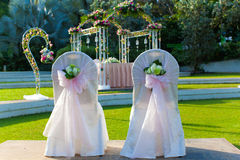 Wedding Couple Chair. With wedding arch in a outdoor garden setting Stock Image