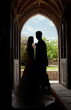 Wedding couple in church entrance Royalty Free Stock Images
