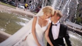 Wedding couple in a city. Wedding couple walking in a city stock video footage