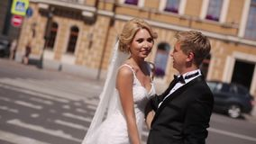 Wedding couple in a city. Wedding couple walking in a city stock footage